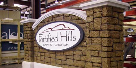 example of a church entrance sign monument with faux stone texture and sandblasted sign panel