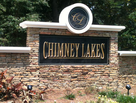 Chimney Lakes entrance sign monument - After picture