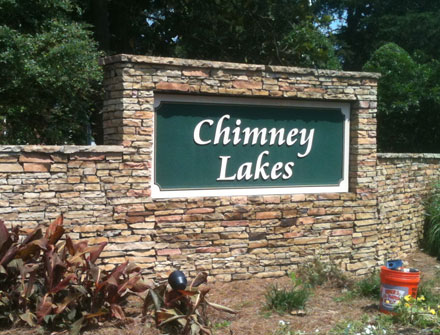 Chimney Lakes entrance sign monument - Before picture