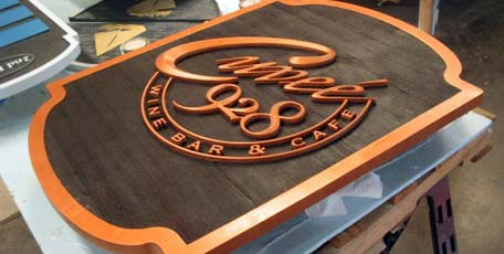 copper prismatic letters mounted sandblasted faux cast sign shield