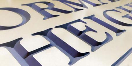 compare cnc routed and sandblasted style signs.