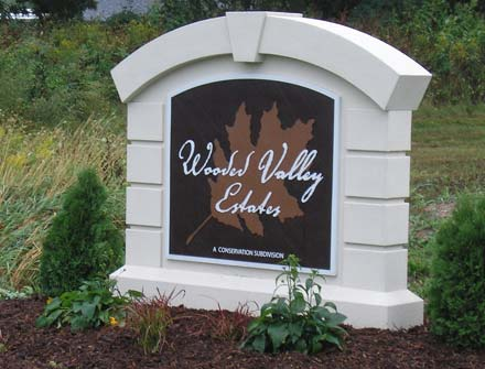 Completed monument sign installed with landscaping